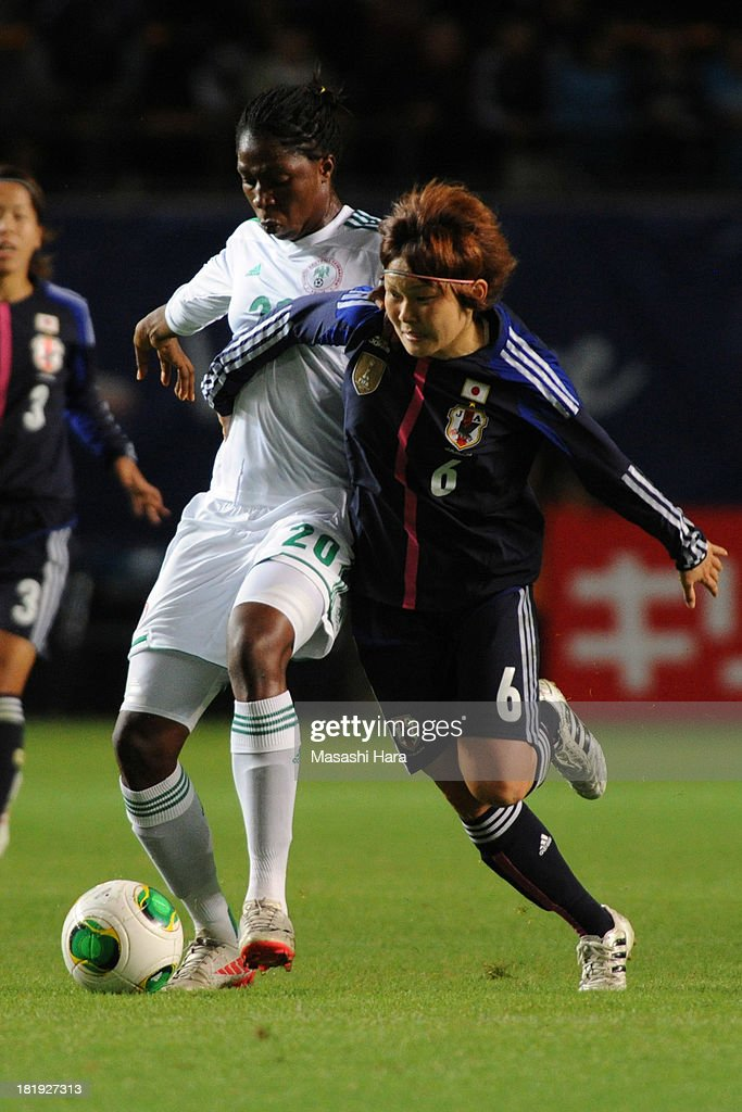 Mizuho Sakaguchi #6 of Japan (R) and Uchechi Lopez Sunday #20 of Nigeria compete for the ball during the Women's international friendly match between Japan and Nigeria at Fukuda Denshi Arena on September 26, 2013 in Chiba, Japan.