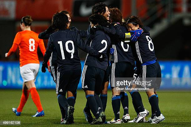 Mizuho Sakaguchi of Japan celebrates scoring her teams first goal of the game with team mates during the International Friendly match between...