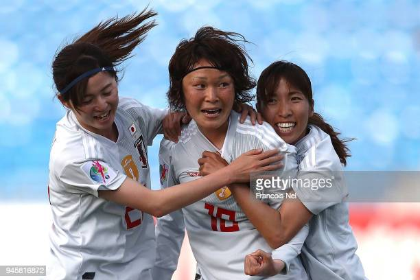 Mizuho Sakaguchi of Japan celebrates with Risa Shimizu and Emi Nakajima scoring the opening goal during the AFC Women's Asian Cup Group B match...