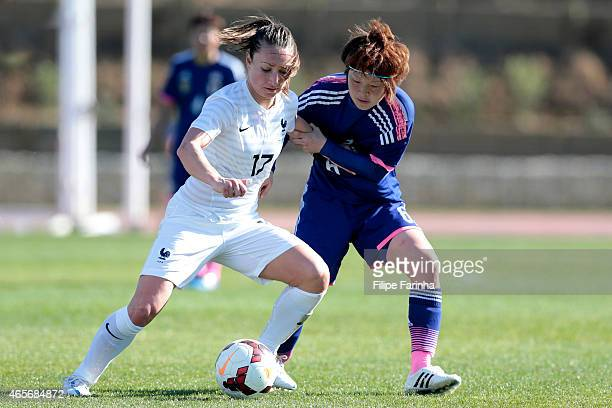 Mizuho Sakaguchi of Japan challenges Gaetane Thiney of France during the Women's Algarve Cup match between Japan and France on March 9 2015 in...