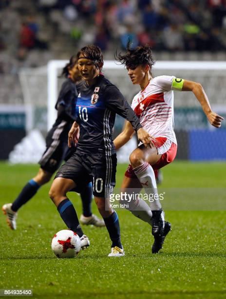 Mizuho Sakaguchi of Japan controls the ball under pressure of Lia Walti of Switzerland during the international friendly match between Japan and...