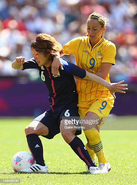 Mizuho Sakaguchi of Japan is tackled by Kosovare Asslani of Sweden during the Women's Football first round Group F Match of the London 2012 Olympic...