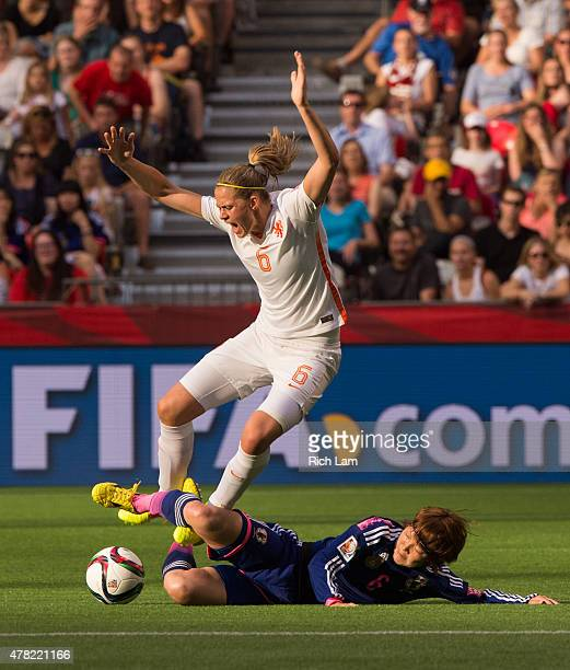 Mizuho Sakaguchi of Japan makes a sliding tackle on Anouk Dekker of the Netherlands during the FIFA Women's World Cup Canada 2015 Round of 16 match...