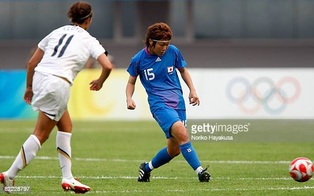 Mizuho Sakaguchi of Japan passes the ball during the Women's Group G match between Japan and USA on Day 1 of the Beijing 2008 Olympic Games on August...
