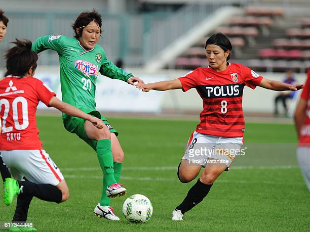 Mizuho Sakaguchi of NTV Beleza and Hikaru Naomoto of Urawa Red Diamonds compete for the ball during the Nadeshiko League match between Urawa Red...