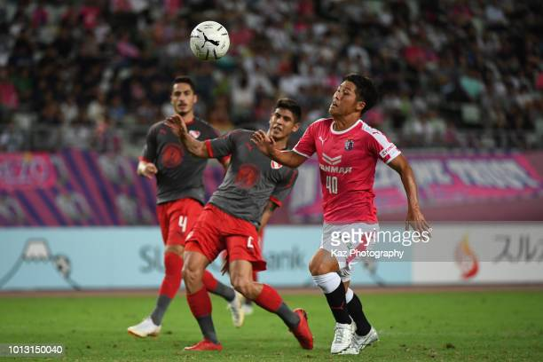Mizuki Ando of Cerezo Osaka and Alan Javier Franco of Independiente compete for the ball during the Suruga Bank Championship match between Cerezo...