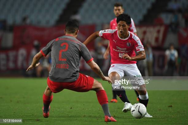Mizuki Ando of Cerezo Osaka takes on Alan Javier Franco of Independiente during the Suruga Bank Championship match between Cerezo Osaka and...