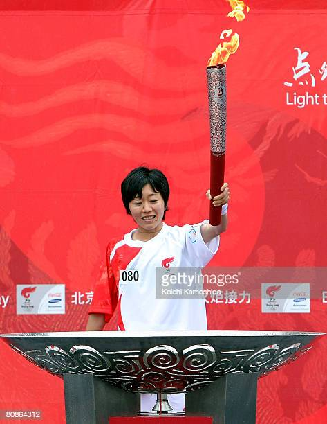 Mizuki Noguchi future women's marathon participant of Beijing lights the cauldron at the end of the Olympic Torch relay at Wakazato Park on April 26...