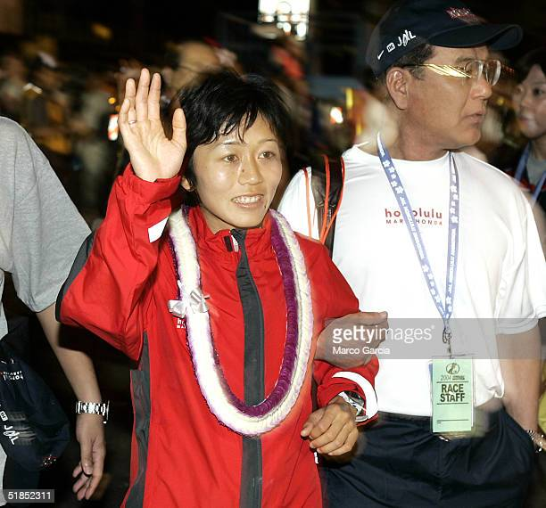 Mizuki Noguchi Japan's Gold Medal marathon winner at the 2004 Athen's Olympics gestures as she is escorted throught the crowd of runners at the start...