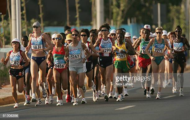 Mizuki Noguchi of Japan and Paula Radcliffe of Great Britian lead the pack in the women's marathon on August 22 2004 during the Athens 2004 Summer...