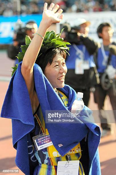 Mizuki Noguchi of Japan celebrates winning the Tokyo International Women's Marathon at the National Stadium on November 18 2007 in Tokyo Japan