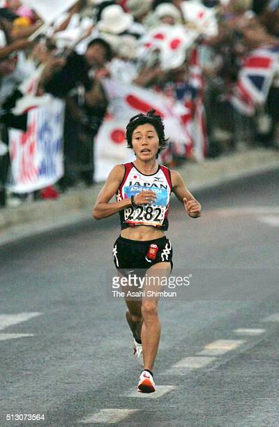Mizuki Noguchi of Japan competes in the Women's Marathon during day nine of the Athens Olympics on August 22 2004 in Athens Greece