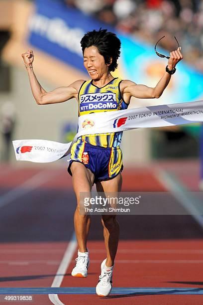 Mizuki Noguchi of Japan crosses the finishing tape as she celebrates winning the Tokyo International Women's Marathon at the National Stadium on...
