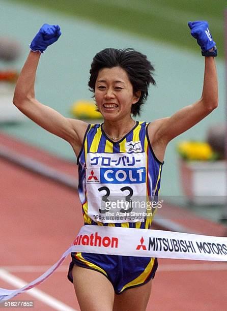 Mizuki Noguchi of Japan crosses the finishing tape to win the 22nd Osaka Women's Marathon at the Nagai Stadium on January 26 2003 in Osaka Japan