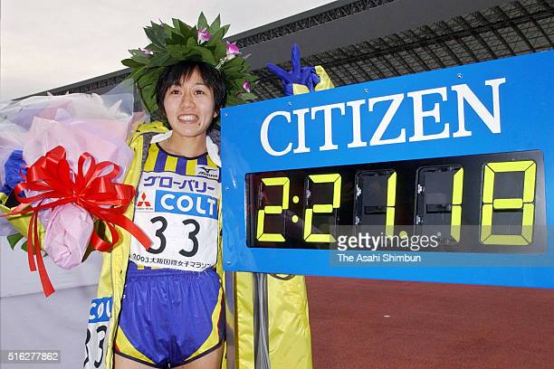 Mizuki Noguchi of Japan poses for photographs after the 22nd Osaka Women's Marathon at the Nagai Stadium on January 26 2003 in Osaka Japan