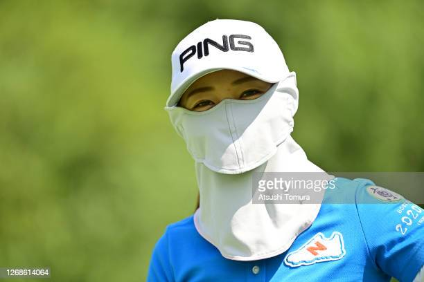 Mizuki Ooide wearing a face mask is seen during a practice round ahead of the Nitori Ladies Golf Tournament at the Otaru Country Club on August 26...