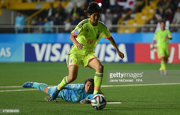 Mizuki Saihara of Japan goes round Heidi Salas of Paraguay to score her goal during the FIFA U17 Women's World Cup Group C match between Paraguay and...
