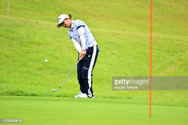 Mizuki Tanaka of Japan chips onto the 1st green during the first round of the GOLF5 Ladies Tournament at the GOLF5 Country Mizunami Course on...