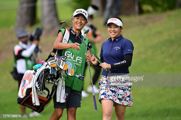 Mizuki Tanaka of Japan receives the putter on the 18th green during the second round of the GOLF5 Ladies Tournament at the GOLF5 Country Mizunami...