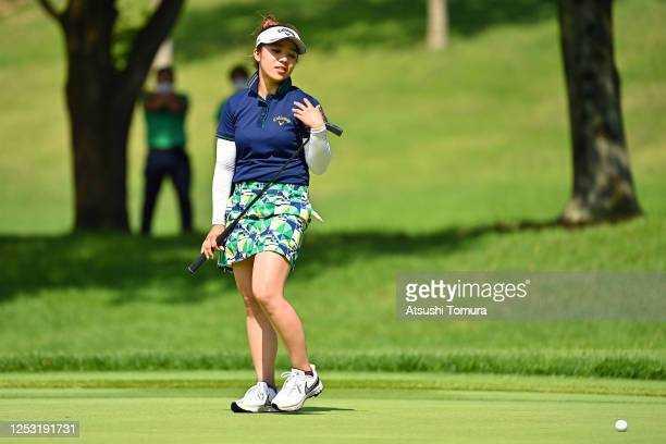 Mizuki Tanaka of Japan shows dejection after missing the birdie putt on the 18th green during the final round of the Earth Mondamin Cup at the...