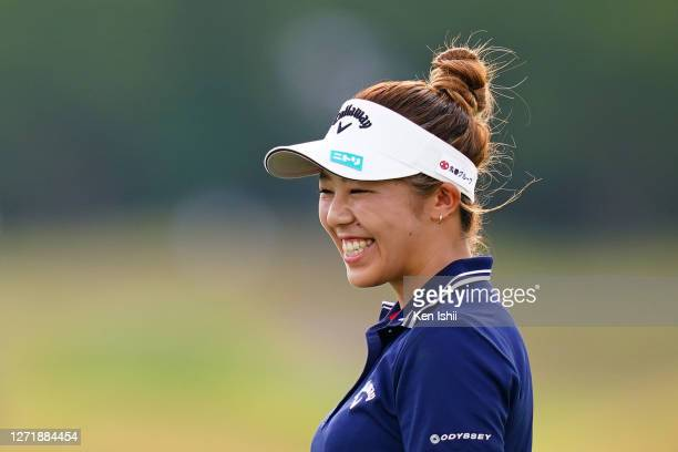 Mizuki Tanaka of Japan smiles after holing out on the 18th green during the second round of the JLPGA Championship Konica Minolta Cup at the JFE...