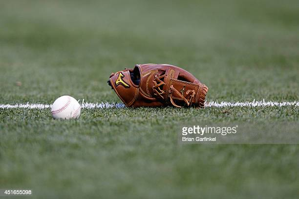 Mizuno glove sits in the grass before the game between the Atlanta Braves and the Philadelphia Phillies at Citizens Bank Park on April 14 2014 in...