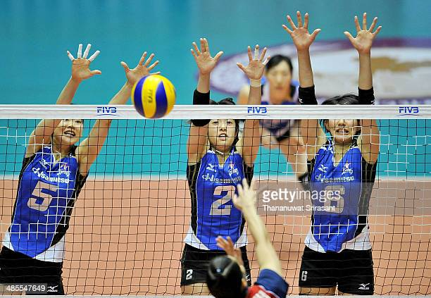 Mizuta Yumi Kotoh Chizura and Ishii Yuki of Hisamitsu block as their competitor spikes during the FIVB 17th Princess Cup Asian Women's Cup Volleyball...