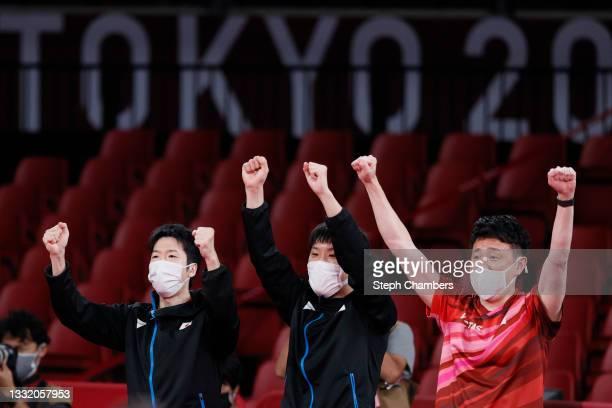 Mizutani Jun and Harimoto Tomokazu of Team Japan react during their Men's Team Quarterfinals table tennis match on day eleven of the Tokyo 2020...