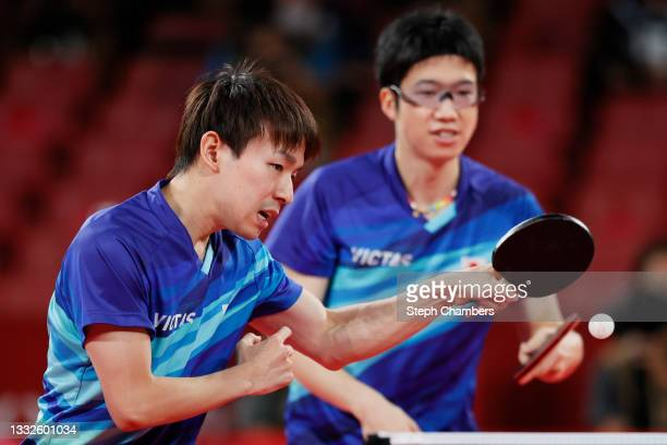 Mizutani Jun and Koki Niwa of Team Japan in action during their Men's Team Bronze Medal table tennis match on day fourteen of the Tokyo 2020 Olympic...