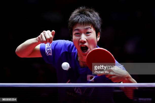 Mizutani Jun of Japan in action at the men's singles quarter-final compete with Lin Gaoyuan of China during the 2018 ITTF World Tour China Open on...