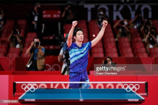 Mizutani Jun of Team Japan celebrates winning his Men's Team Bronze Medal table tennis match on day fourteen of the Tokyo 2020 Olympic Games at Tokyo...
