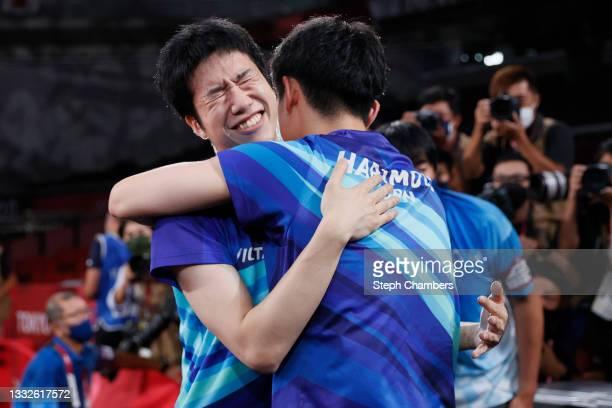 Mizutani Jun of Team Japan hugs his teammate Harimoto Tomokazu after winning during their Men's Team Bronze Medal table tennis match on day fourteen...