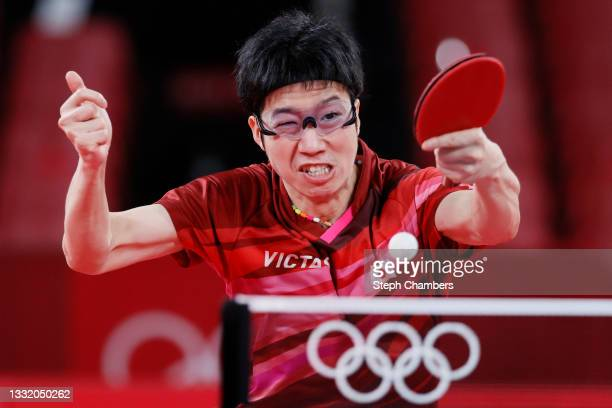 Mizutani Jun of Team Japan in action during his Men's Team Quarterfinals table tennis match on day eleven of the Tokyo 2020 Olympic Games at Tokyo...