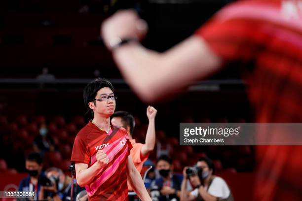 Mizutani Jun of Team Japan reacts during his Men's Team Semifinals table tennis match on day twelve of the Tokyo 2020 Olympic Games at Tokyo...