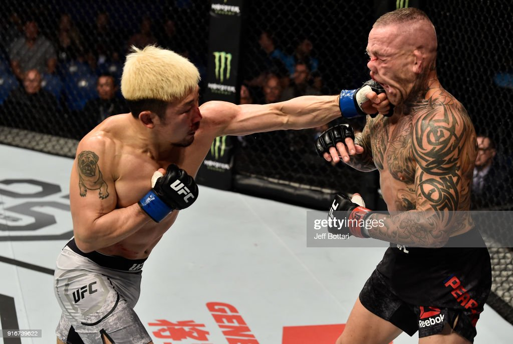 Mizuto Hirota of Japan punches Ross Pearson of England in their lightweight bout during the UFC 221 event at Perth Arena on February 11, 2018 in Perth, Australia.