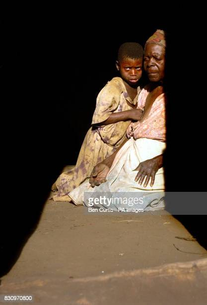 Mjiyasi Gungulou comforts her greatgranddaughter Mdakalira whom she was left to look after following the death from AIDS of her granddaughter and...