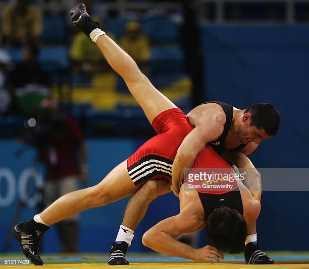 Mkkhitar Manukyan of Kazakhstan throws Jimmy Samuelsson of Sweden during the men's GrecoRoman wrestling 66 kg bronze medal match round on August 25...