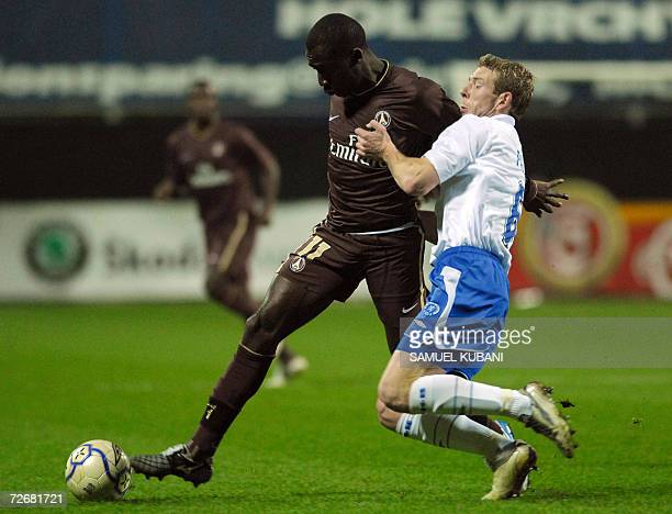 Paris Saint Germain's Amara Diane fights for the ball with Marian Palat of Mlada Boleslav during their UEFA Group G football match in Mlada Boleslav...
