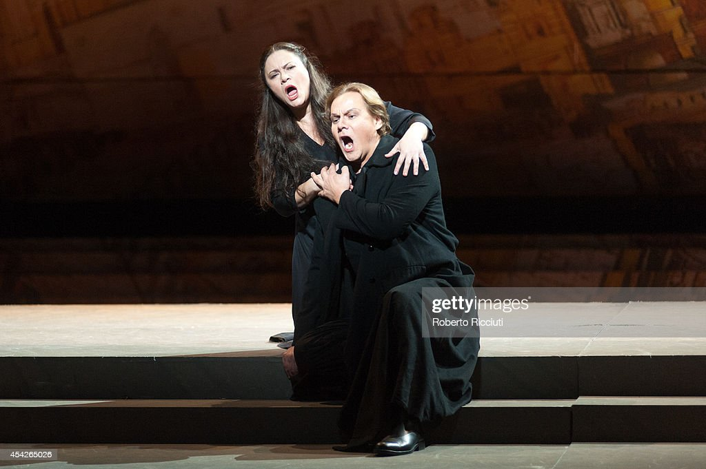 Mlada Khudoley and Alexey Markov of Mariinsky Opera perform during a photocall for 'Les Troyens' at the Edinburgh International Festival at Festival Theatre on August 27, 2014 in Edinburgh, Scotland.