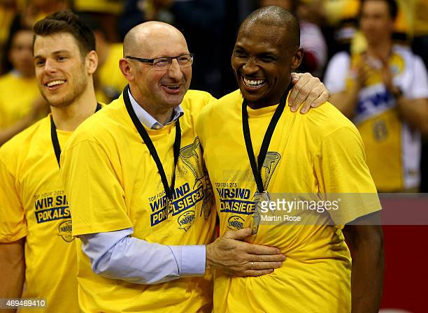 Mladen Drijencic head coach of Oldenburg celebrate with Rickey Paulding after winning the BEKO BBL Top Four final game between EWE Baskets Oldenburg...
