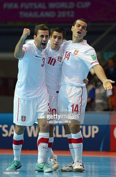 Mladen Kocic of Serbia celebrates scoring his teams first goal with team mates Aleksandar Zivanovic and Slobodan Rajcevic during the FIFA Futsal...