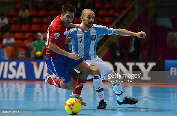 Mladen Kocic of Serbia is challenged by Damian Stazzone of Argentina during the FIFA Futsal World Cup Round of 16 match between Serbia and Argentina...