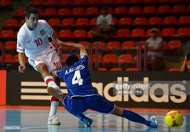 Mladen Kocic of Serbia scores his teams first goal next to Ahmad Alfarsi of Kuwait during the FIFA Futsal World Cup Group E match between Kuwait and...