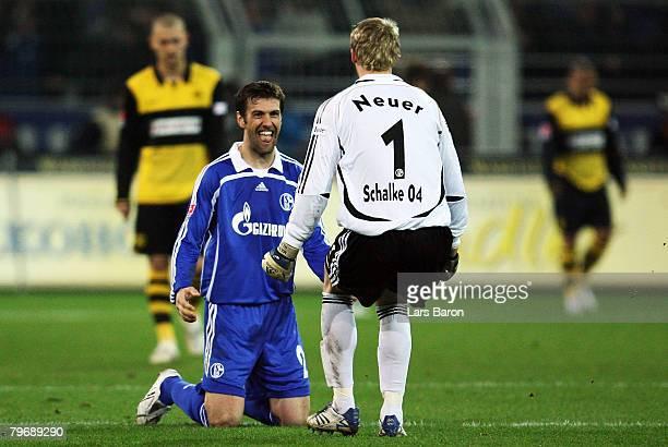 Mladen Krstajic and Marnuel Neuer of Schalke celebrate after team mate Fabian Ernst scored the fifth goal during the Bundesliga match between...