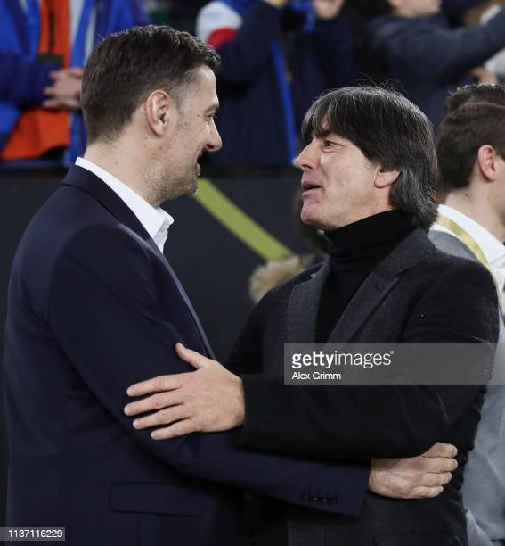 Mladen Krstajic Head Coach of Serbia and Joachim Loew Head Coach of Germany greet each other prior to the International Friendly match between...