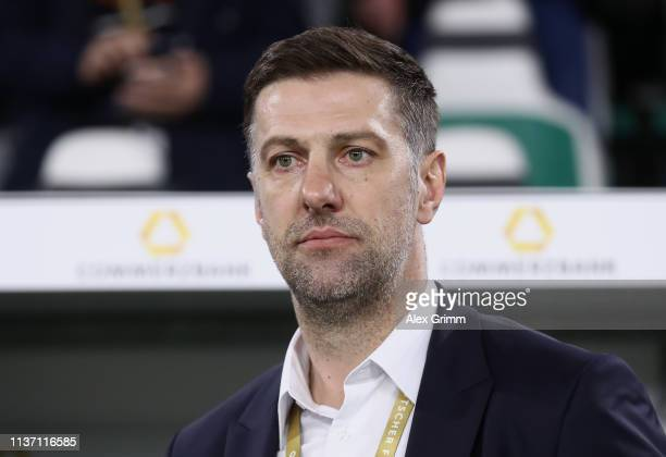 Mladen Krstajic Head Coach of Serbia looks on prior to the International Friendly match between Germany and Serbia at Volkswagen Arena on March 20...