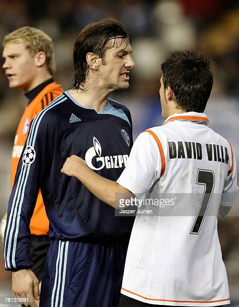 Mladen Krstajic of Schalke argues with David Villa of Valencia during the UEFA Champions League Group B match between Valencia and Schalke at the...