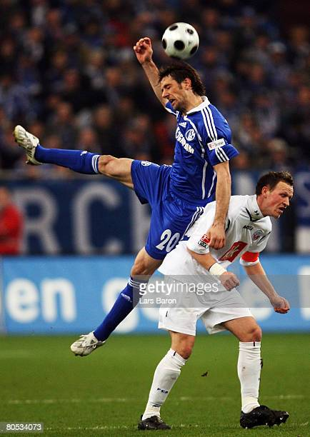 Mladen Krstajic of Schalke in action with Enrico Kern of Rostock during the Bundesliga match between Schalke 04 and Hansa Rostock at the Veltins...