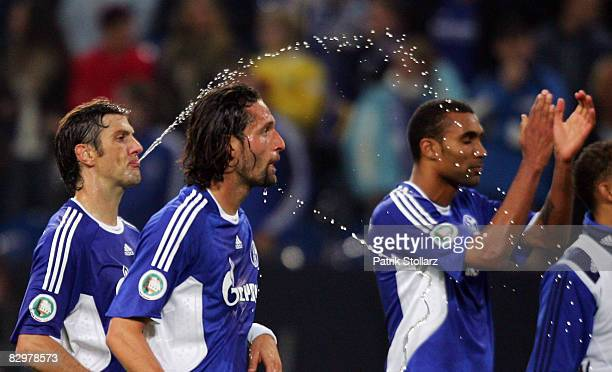 Mladen Krstajic spits on Kevin Kuranyi after the DFB Cup Second Round match between FC Schalke 04 and Hannover 96 at the Veltins Arena on September...