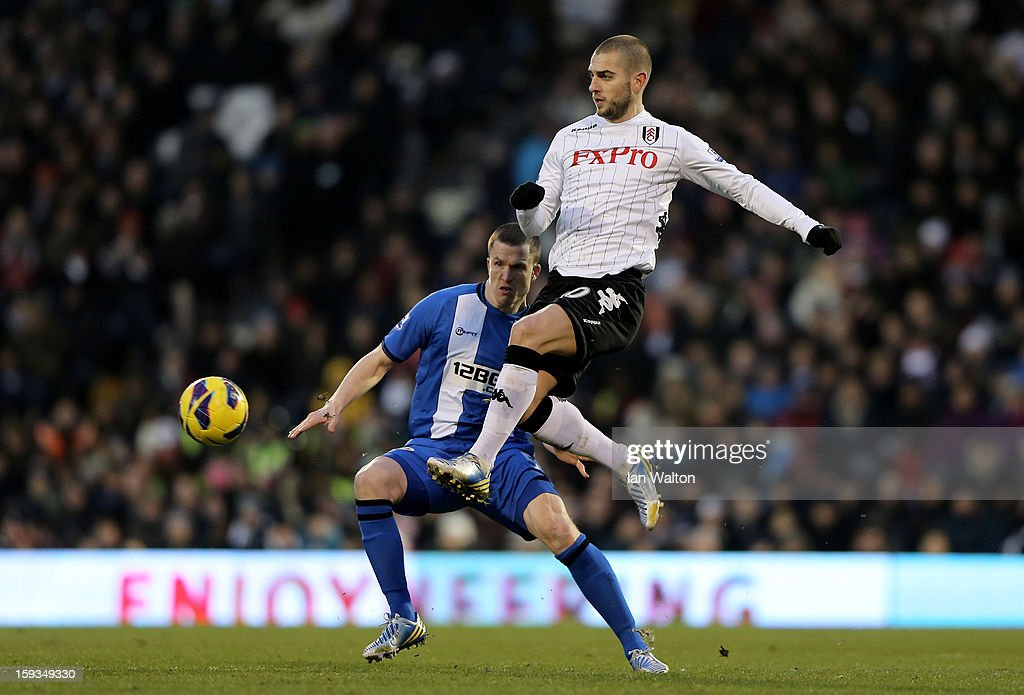 Mladen Petric of Fulham controls the ball as Gary Caldwell of Wigan closes in during the Barclays Premier League match between Fulham and Wigan Athletic at Craven Cottage on January 12, 2013 in London, England.